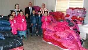 ŞUTSO'dan 888 fakir öğrenciye giyim yardımı