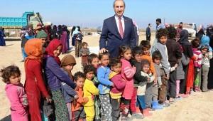 Telabyad'daki ailelere gıda ve giysi yardımı